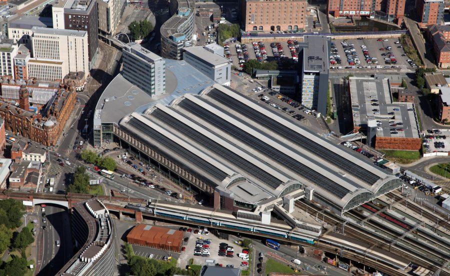 an aerial view of Manchester Piccadilly station showing the stations approach tracks, the platform canopy and the main building.