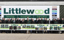 Staff of Littlewood Fencing lined up behind banner