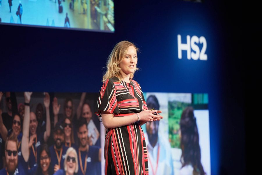 Sam pictured on stage speaking at a HS2 event.