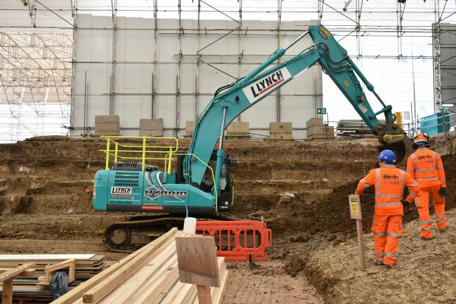 Hybrid-powered excavator in use.