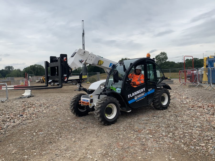electric forklift telehandler on a construction site.