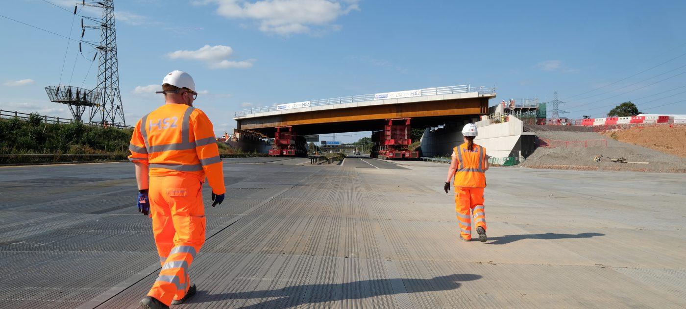 2 workers walking away