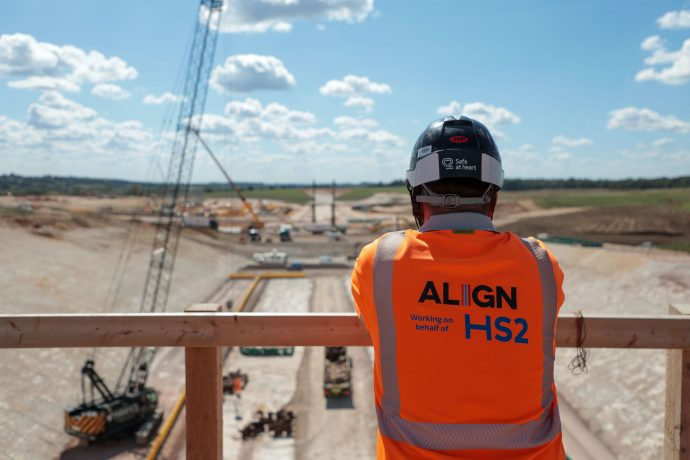 HS2 worker in orange PPV looking over construction site