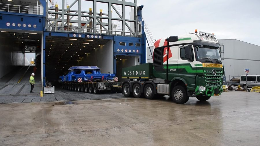 Parts of an HS2 tunnelling machine are driven off a ferry on a lorry.