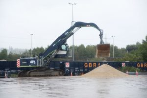 Aggregate is unloaded from a freight train.