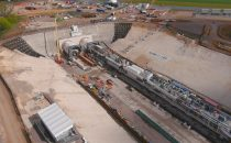 An aerial picture of tunnel boring machines sitting in a cutting.