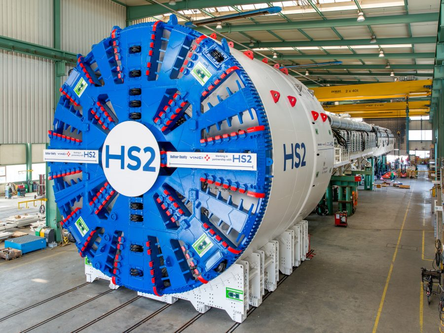 The circular cutting head of a tunnel boring machine under going assembly.